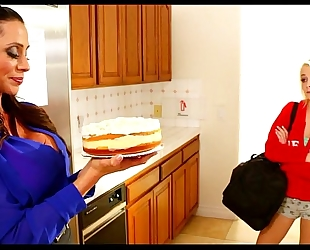 Lesbian mommy and daughter have cake time
