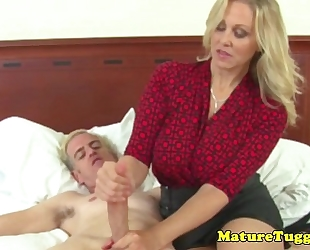 Busty aged milf receives cum on pantoons after hj