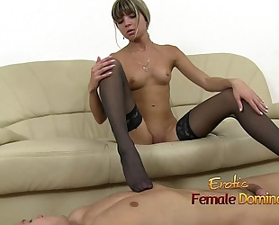 Gina wears dark nylons during the time that strokes knob with her feet