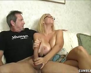 Huge-titted milf enjoys jerking dongs