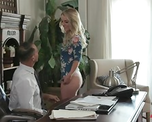Easygoing harlot servicing two dicks in the office