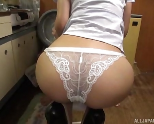 Horny Asian dude fucks his wife in the kitchen and cums on her ass