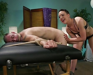 Short-haired mistress with small tits dominates over her slave