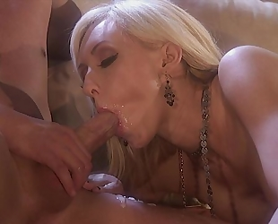 Two horny stallions fuck glamorous bitch on the couch