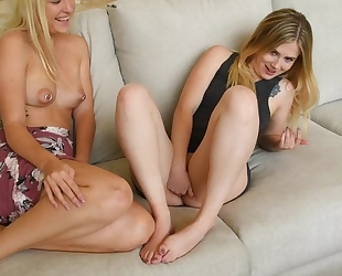 Two lusty blonde babes having fun in the living room