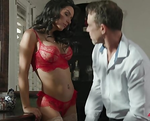 Exotic brunette with fake boobs sucks bunch of hard cocks at once