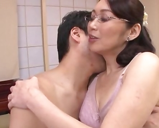 Japanese housewife with glasses gets fucked balls deep