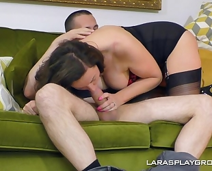 Lusty housewife in black stockings boned in the living room
