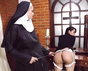 Perverted nun fucks her girlfriend with strapon dildo