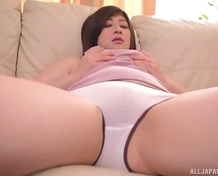 Juicy Asian lady with natural breasts masturbates on the sofa