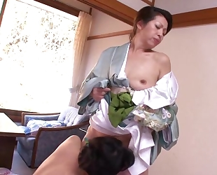 Two horny Asian MILFs playing lesbian games in bed