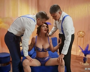 Big breasted minx in sexy lingerie serves two hard dicks