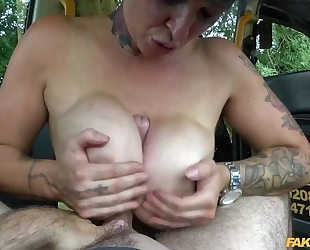Short-haired bitch with tattoos pleasuring her taxi driver