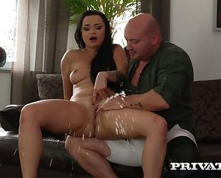 Bald-headed dude fucks whorish brunette and makes her squirt