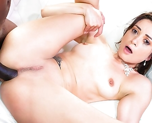 Dark-haired nympho gets brutally fucked by horny black dude